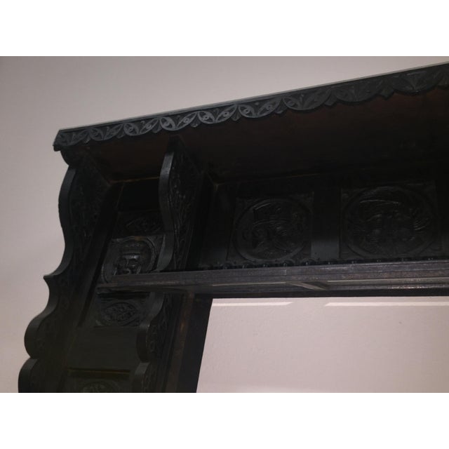 Antique black wood fireplace mantel, 2 pieces. Fire box opening is 36 inches wide and 32 inches high. Base of the...