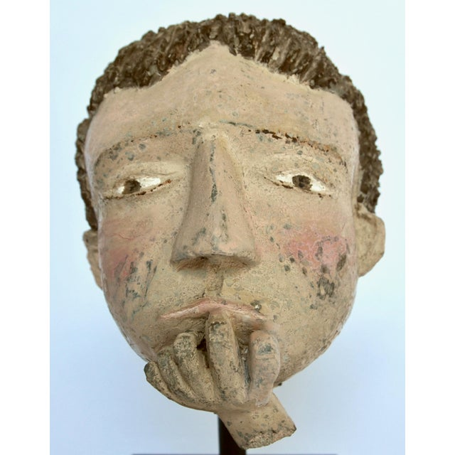 A fascinating and curious American Folk sculpture cement head of a thoughtful looking boy salvaged from a larger sculpture...