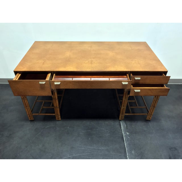 Stunning vintage desk by Henredon. Made in North Carolina, USA circa 1970s. Twin rattan pedestals support the desk with a...