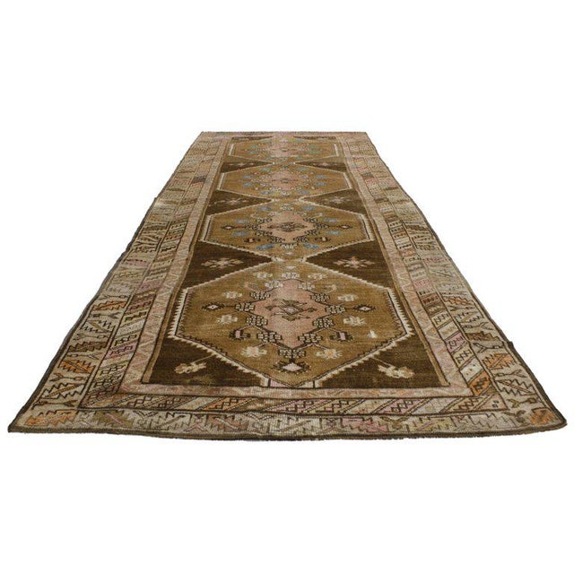 Full of character and stately presence, this vintage Turkish Kars rug with modern style showcases an extravagant geometric...