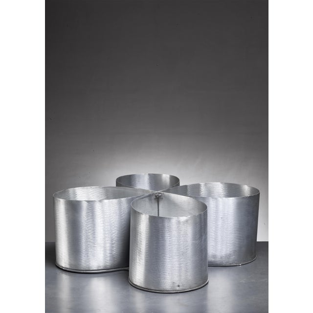 A metal plant holder by Italian designer Lorenzo Burchiellaro. It is made of four metal shields, held together in the...
