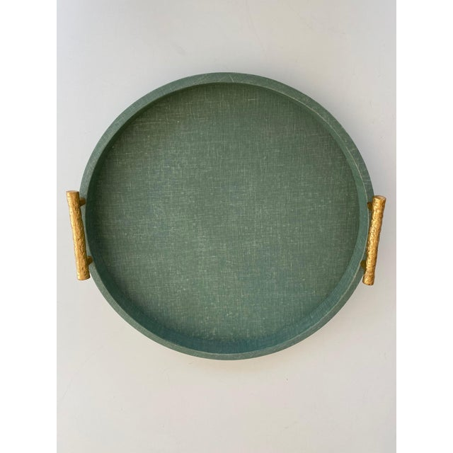 A beautiful green tray with gold bamboo handles works beautifully on a vanity table to organize bottles and baubles or as...