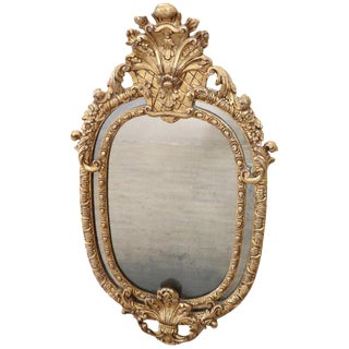 19th Century Italian Baroque Style Carved Gilded Wood Oval Wall Mirror For Sale