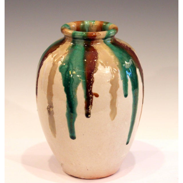Vintage Awaji vase in traditional tea jar form with multicolored drip glaze drizzling down from the rim, circa 1930....