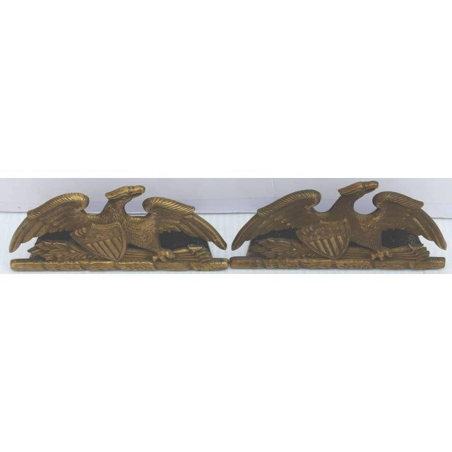 This pair of solid brass are in great as found condition. This is a large oversize eagle flanked on a patriotic shield and...