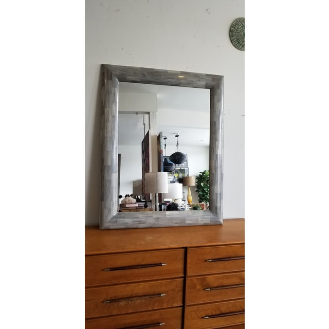 Reflect on a classic. This gray Faux Horn rectangular mirror brings dimension and texture to any room. Designed to have...