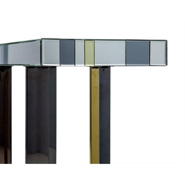 Thick, mirror-topped console table with dark platinum, gold and regular mirror stripes. Dark platinum and gold finished...