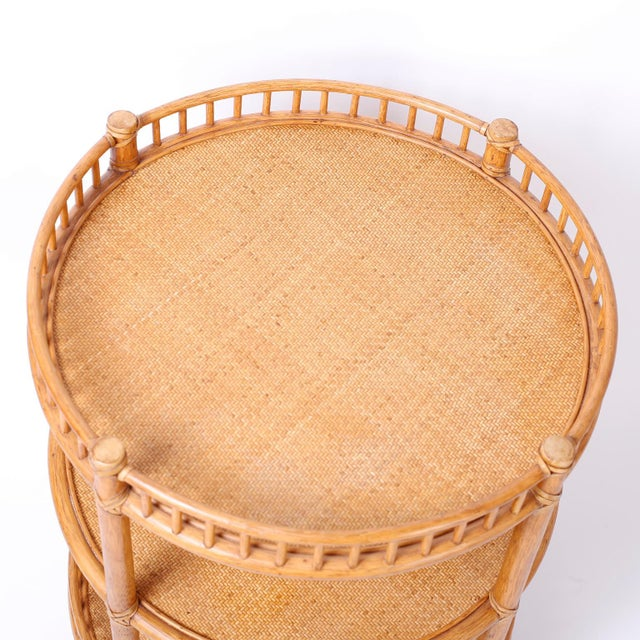 Here is an intriguing pair of three-tiered round stands with ubiquitous appeal. Featuring grass cloth plateaus, galleries...