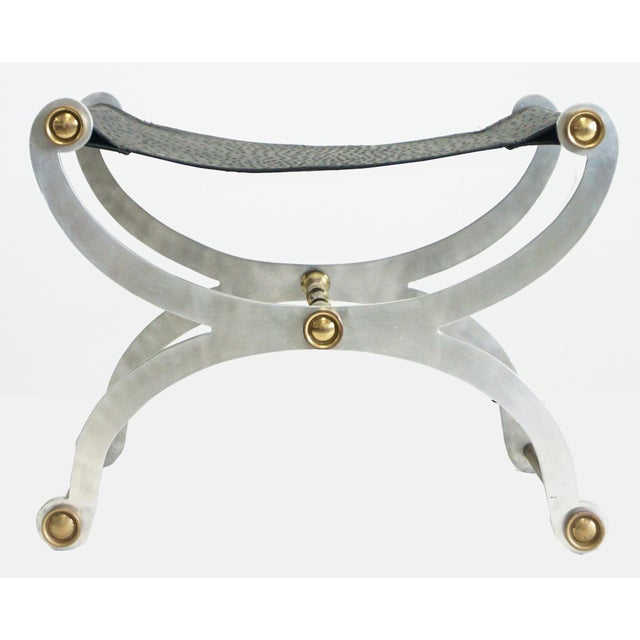 Fabulous stool in the style of Maison Jansen. Features a brass and steel frame and a faux ostrich leather seat. Please...