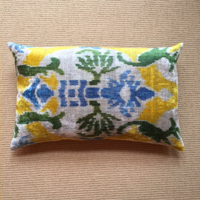 This beautiful pillow is made from soft silk thread with an eye-catching design sure to brighten any room.
