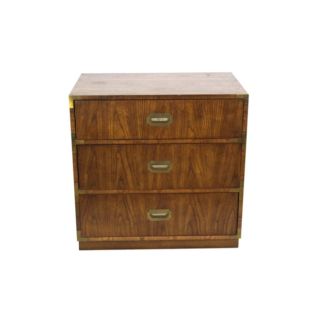 Mid century campaign style 3-drawers walnut commode with metal hardware Some wear, consistent with age and use Dimensions;...