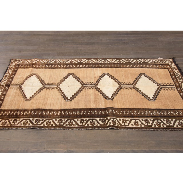 Vintage hand-knotted Persian Shiraz with a geometric design. This rug has magnificent detailing and would be perfect for...
