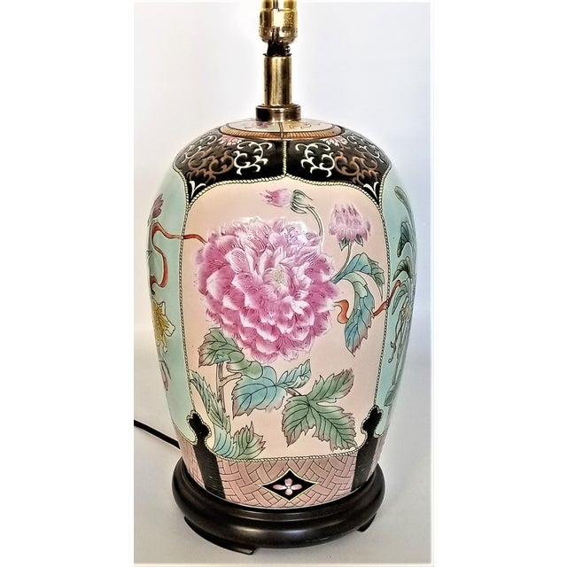 Offering a stunning vintage Famille Rose Chinese export lamp, circa 1960s. SHADE NOT INCLUDED. Most likely the ceramic is...