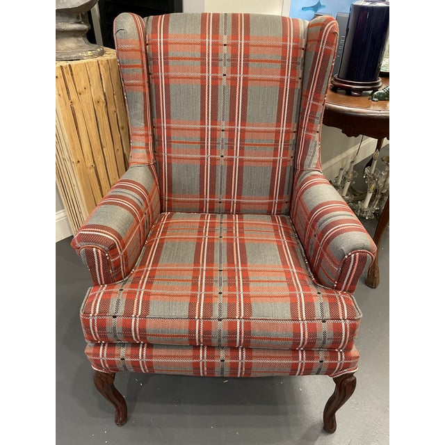 This is a beautiful french wingback chair. The mahogany base pairs beautifully with the sunbrella plaid fabric. The french...