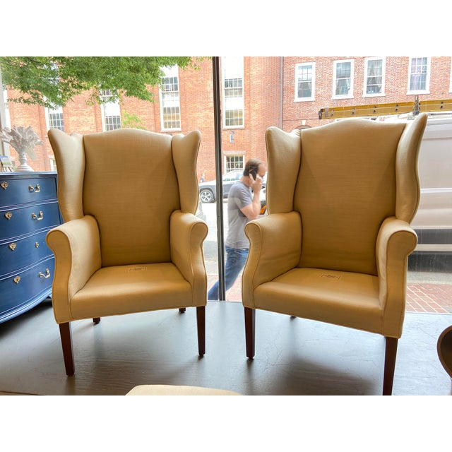 This lovely pair of Wingback chairs are beautiful reupholstered antiques. The base of the chairs is mahogany and is in...