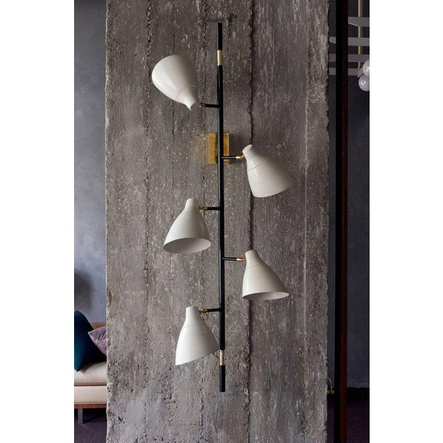 Stunning pair of wall lamps or sconces. Each wall lamp has five illuminated cones. The lamps are in excellent condition....
