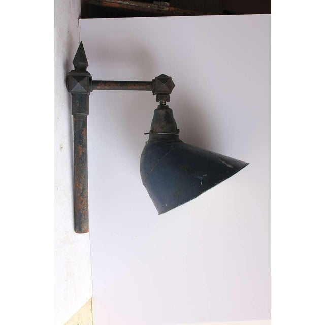 Antique Industrial wall sconce in blue tone. This piece would make a great gift for those interested in antique sconces.