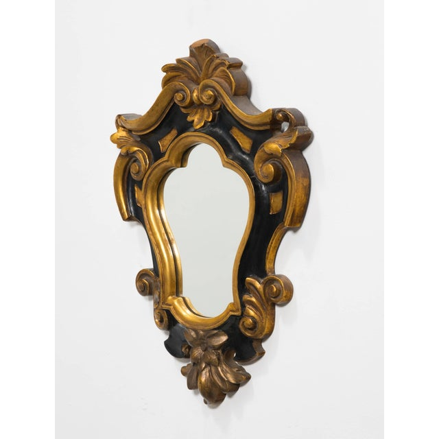 1930s carved wood decorative Rococo style mirror. Great metal label on the back.