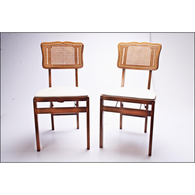 (2) Vintage Wooden Folding Chair Set. Solid hardwood with caned back. Easy to use design. Can hold adult weight. Folds up...