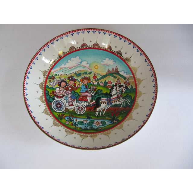Vintage Arta Enamel Bowl With Whimsical Scene of a couple in a horse drawn carriage driving by a castle. Marked on reverse...
