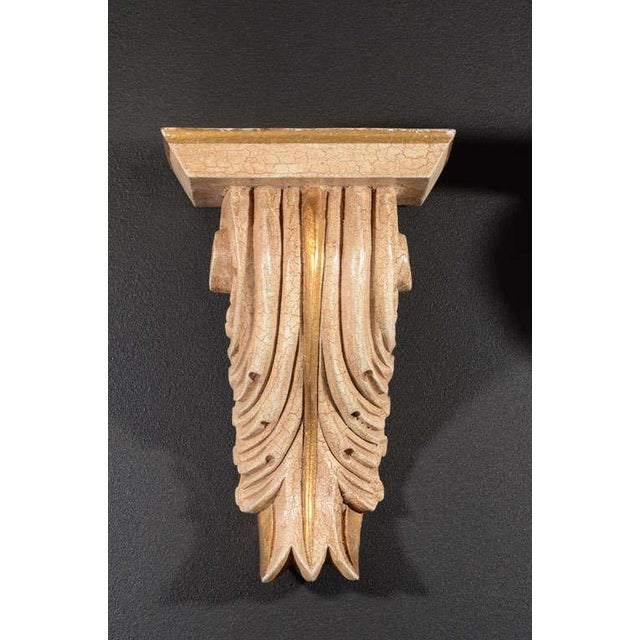Hollywood Regency wall brackets with classical acanthus leaf design. Hand-carved with crackle pattern Gesso finish and...