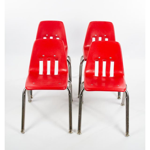 These fun and vibrant Mid-Century stacking school chairs would be perfect for the kiddos! The retro design makes them easy...