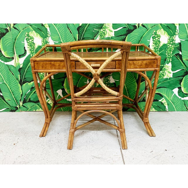 Vintage bamboo and rattan desk from the Philippines features gated top and splayed legs, along with a unique two-toned...