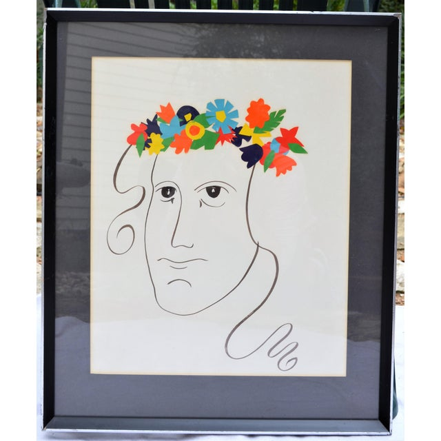 This is an early art piece by Brody Neuenschwander. It is an abstract face drawn in black ink on on paper with floral...