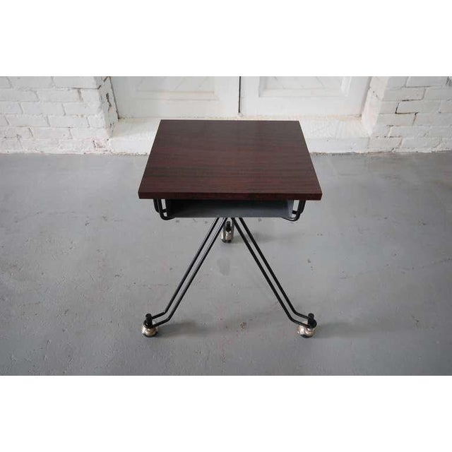 Rolling table designed by Eliot Noyes for I.B.M., circa 1955. Solid mahogany top has beautiful figuring. Works well as an...