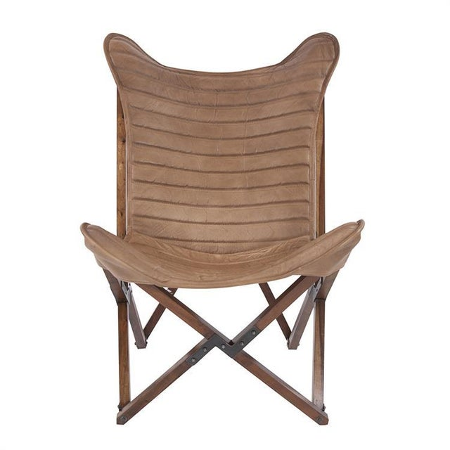 Leather Sling Chair Our Leather Sling Chair embodies casual elegance. It features a chic folding wood frame adorned with a...