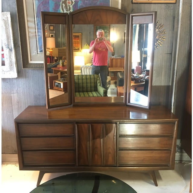 United Furniture walnut lowboy dresser with trifold mirror. The lowboy is in very good vintage condition and has amazing...