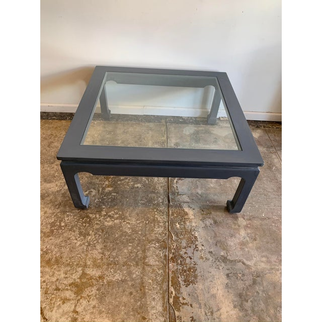 Stained in a an oxford gray, this rectangular wood framed cocktail table with interchangeable top: comes with glass option...