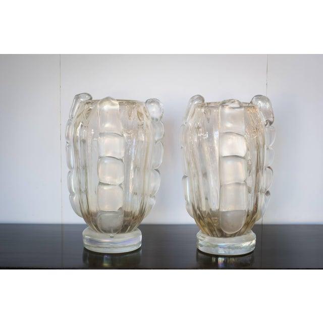 Murano handblown vases of opaline glass made by prestigious Italian glassblower, Sergio Costantini. Clear glass with...