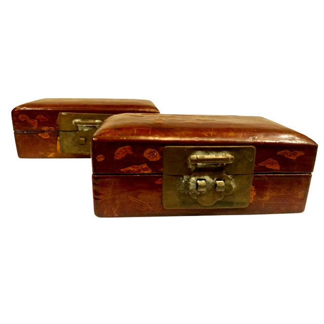 A fabulous pair of early 19th century Chinese boxes with hand carved oriental figures on the exterior and Handpainted...