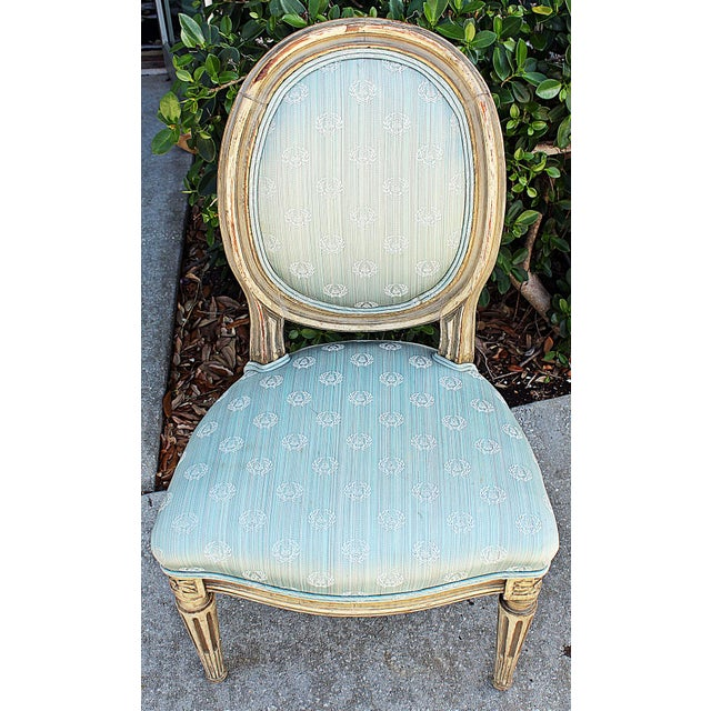 Sweet pair of 19c painted petite French Louis XVI style side chairs in a lovely satin fabric. Authentic shabby paint wear,...
