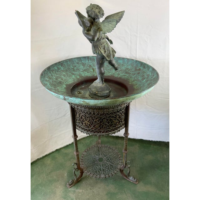 This elegant piece is sure to create a majestic scene in any setting, indoors or out. This ornate mixed metal fountain has...
