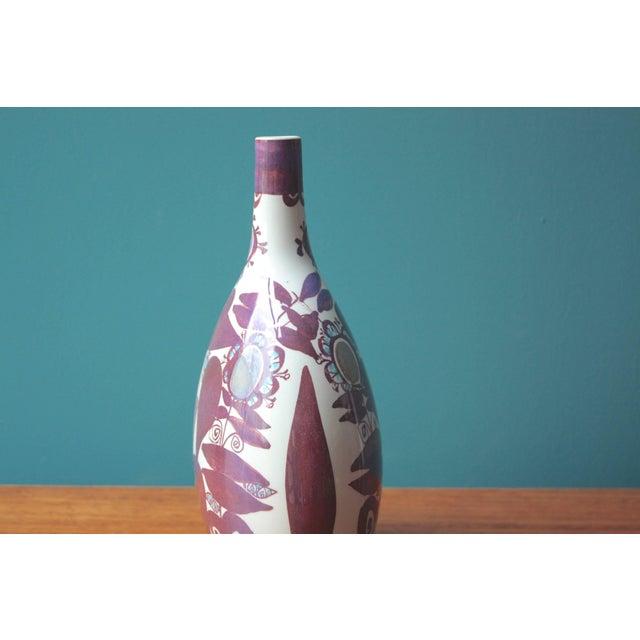 Faience bottle vase designed by Kari Christensen and manufactured by Royal Copenhagen/Aluminia, Denmark, circa 1960s. It...