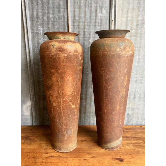 Vintage Pair of Metal Urns. Small hole in bottom of one. Perfect for decoration or to display. Drop a plastic or glass...