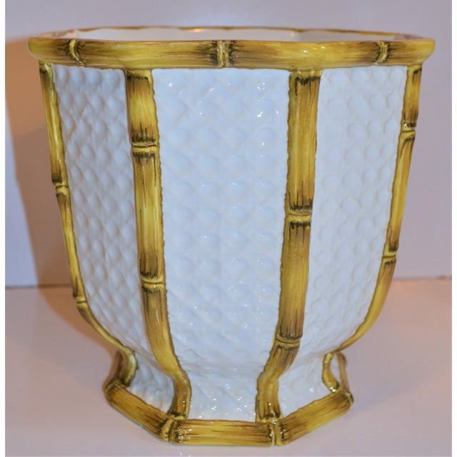 These is a hand painted majolica cachepot from Italy. This is painted in a creamy white and goldenrod brown bamboo color....