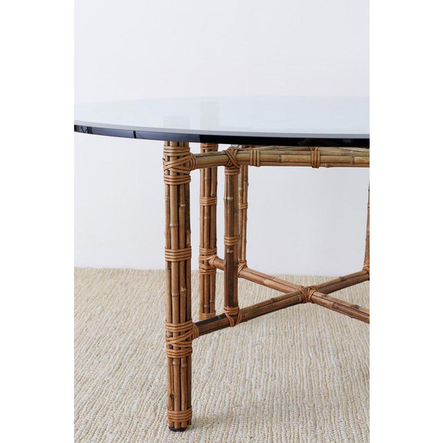 Genuine McGuire organic modern style dining table constructed from an iron frame hand wrapped with bamboo rattan poles....
