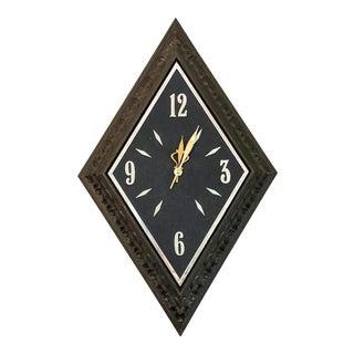 1960s Mid Century Faux Wood Diamond Sunbeam Wall Clock. For Sale