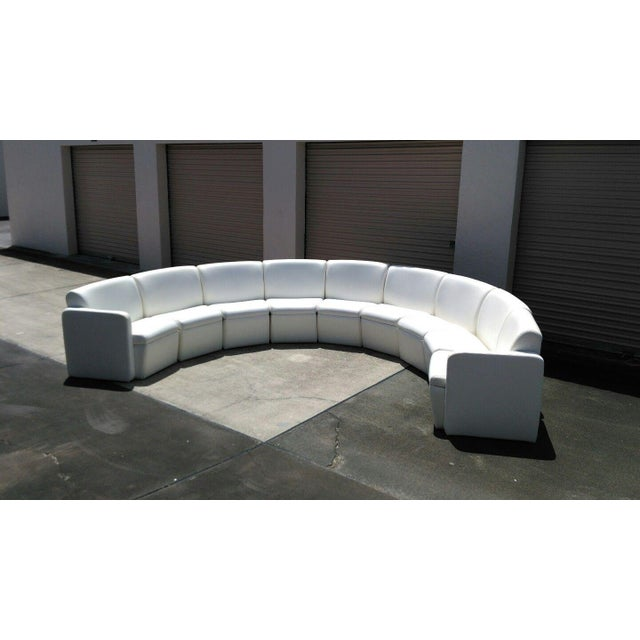 Vintage modern nine piece naugahyde modular sectional in a half circle configuration. Each section is a slight wedge shape...