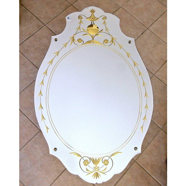 Absolutely beautiful 1930s art deco wall mirror with scalloped bevelled edges and brass rosettes. Reverse side is finely...