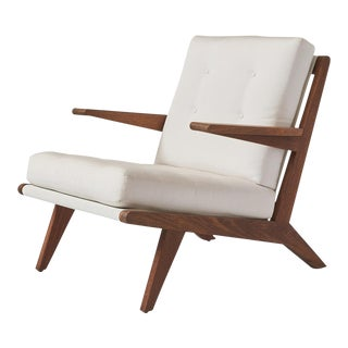 AN OPEN ARMCHAIR EXCLUSIVELY FOR ALMOND & CO.