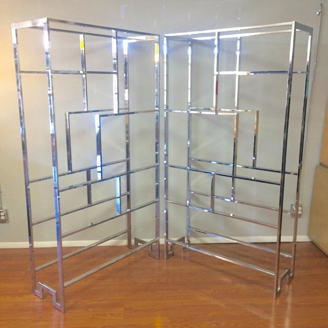 This is an amazing pair of 1970's Milo Baughman-designed chrome-and-glass etageres. These both feature the highly sought...