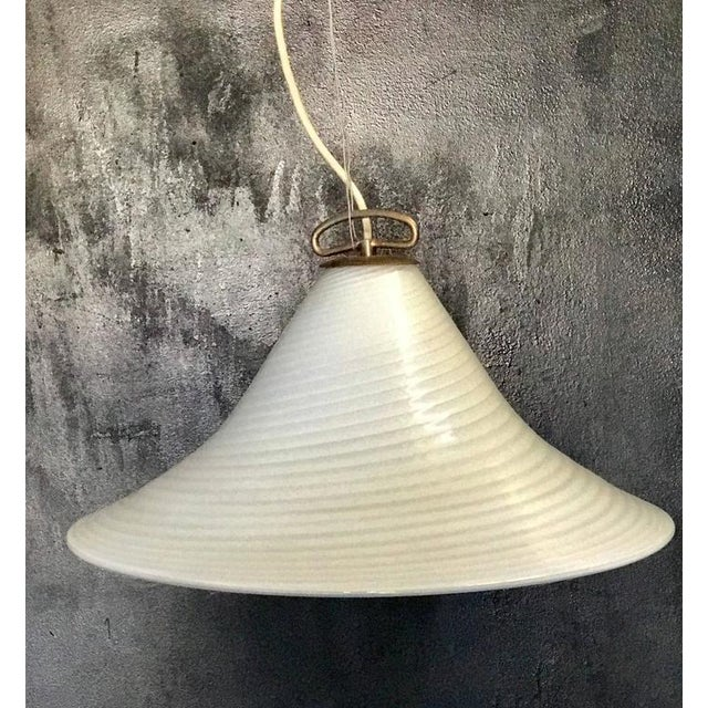 Pendant light from Murano with adjustable height. Beautiful mid-century modern design!