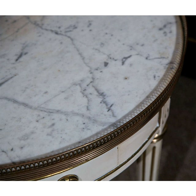 French painted Louis XIV style gueridon table, circa 1940s, the white circular marble with brass gallery, over a round...