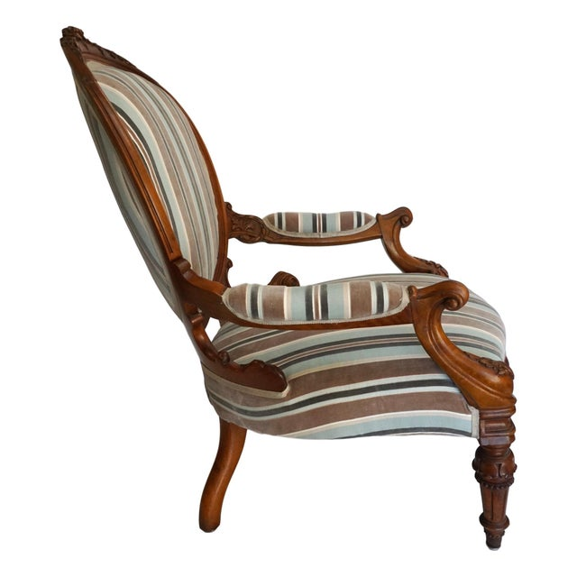 Beautiful 19th century Louis XVI style walnut Fauteuil and foot stool with ornate carving on the frame and legs of the...