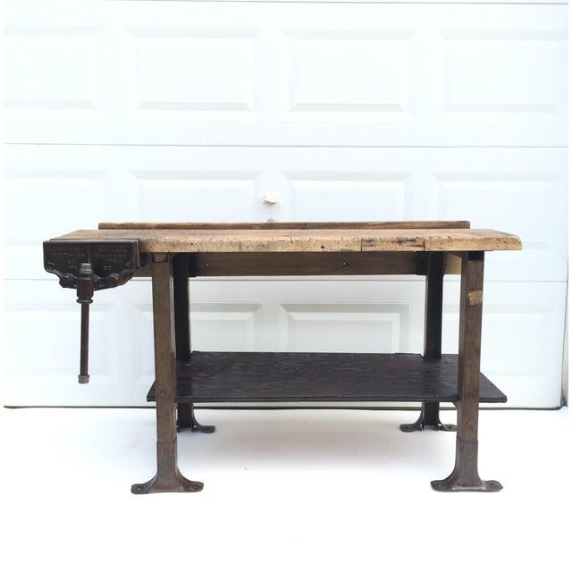 This primitive modern workbench features hardwood and steel construction with early 1900's Table clamp by Toles. Authentic...