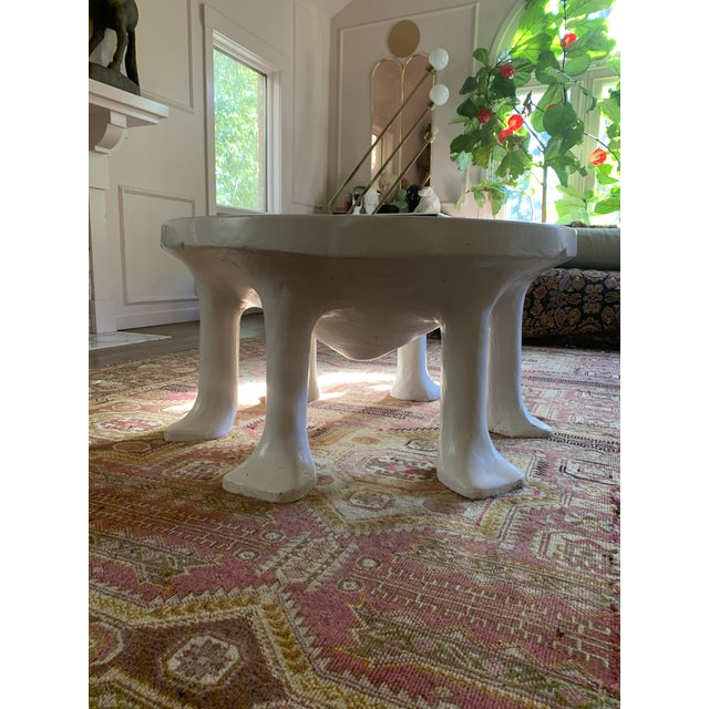 The iconic 6-legged John Dickinson African table for David Sutherland Home. Made of glass fiber reinforced concrete, this...